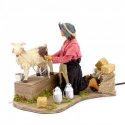 Moving scene of woman milking goat in dressed terracotta 24 cm
