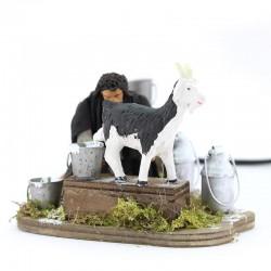 Moving scene of man milking goat in dressed terracotta 12 cm