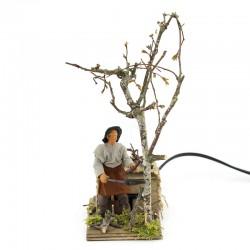 Moving Lumberjack cutting tree in dressed terracotta 10 cm