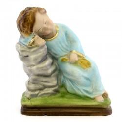 Statua Gesù Bambino dormiente in resina colorata 15 cm