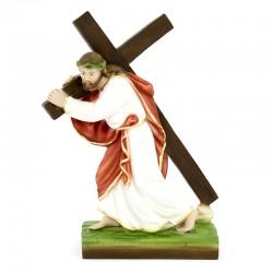 Statua Gesù porta la croce in resina colorata 25 cm