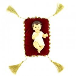 Gesù Bambino in resina colorata su cuscino 15 cm