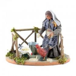 Donna becchime con galline in terracotta vestita 12 cm