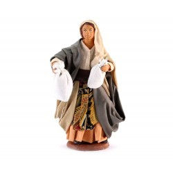 Donna con sacchetti in mano in terracotta 12 cm