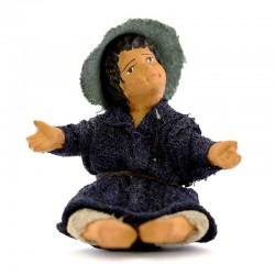 Fanciullo seduto a terra in terracotta vestita 12 cm