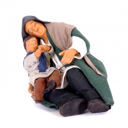 Dressed terracotta sleeping man with child on the legs 12 cm