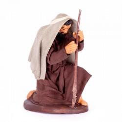 Dressed terracotta kneeling man with head bowed 12 cm