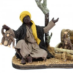 Black man sitting on the ground with monkeys with dressed terracotta 12 cm