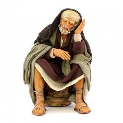 Uomo seduto che si riposa in terracotta vestita 30 cm