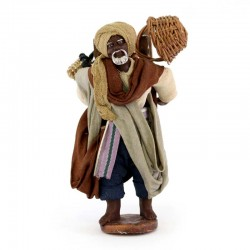Black walking shepherd in terracotta with clothes 10 cm