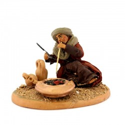 Man blowing on fire with clothes in terracotta 10 cm