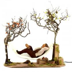 Uomo su amaca in terracotta vestito a movimento 30 cm