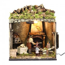 Moving fireplace scene with dressed terracotta children 12 cm