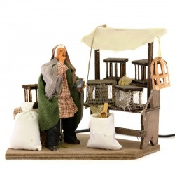 Moving cage seller with dressed terracotta 12 cm