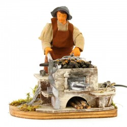 Moving Blacksmith with forge and dressed terracotta 12 cm