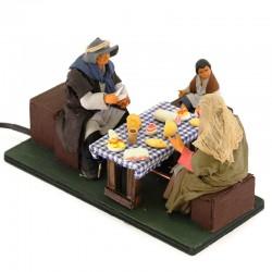 Moving family having dinner with dressed terracotta 12 cm